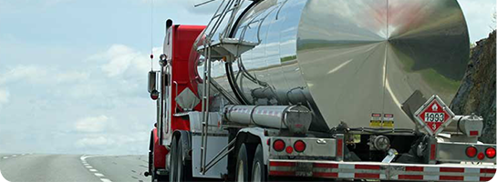 Photo of truck hauling hazardous material tank