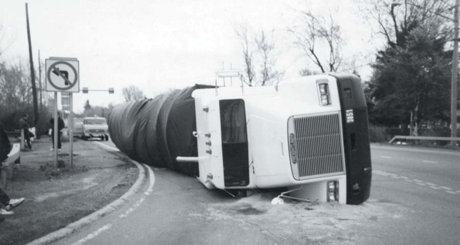 A truck with cargo on its side.