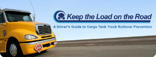 Yellow dump truck with slogan Keep the Load on the Road
