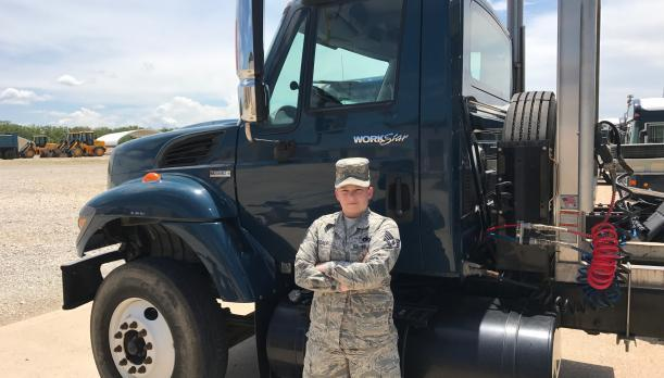 Soldier in front of truck